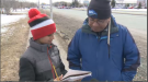 A grade six student at Westboro Academy talks to a CUPE Local 2424 member about strike action