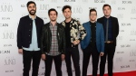 The Arkells pose for photographers as they arrives for the Juno Gala awards show, Saturday April 1, 2017 in Ottawa. THE CANADIAN PRESS/Sean Kilpatrick