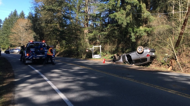 Saanich police and paramedics responded to a rollover crash in the 5600-block of West Saanich Road that trapped a driver inside his vehicle. March 21, 2018. (CTV Vancouver Island)