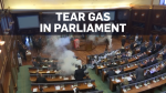 Lawmakers in Kosovo delay vote using tear gas