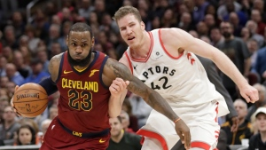 Cleveland Cavaliers' LeBron James (23) drives past Toronto Raptors' Jakob Poeltl (42) during the second half of an NBA basketball game on March 21, 2018, in Cleveland. The Cavaliers won 132-129. (AP Photo/Tony Dejak)