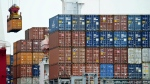 A container is loaded onto a cargo ship at the Tianjin port in China on Aug. 5, 2010. (AP Photo/Andy Wong, File)