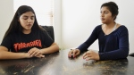 Bianca Retana, 15, left, and her sister, Miranda, 16, right, talk in Albuquerque, N.M., on March 21, 2018. (Russell Contreras /AP)