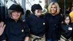 The wife of French President Brigitte Macron poses with handicapped and autistic employees of the Cafe Joyeux restaurant. (Patrick Kovarik / AFP)