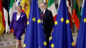 British Prime Minister Theresa May, left, arrives for an EU summit at the Europa building in Brussels on Thursday, March 22, 2018. (AP / Olivier Matthys)