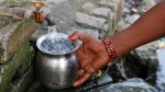 An Indian woman fills drinking water from a public tap on World Water Day in Allahabad, India, Thursday, March 22, 2018. (AP Photo/Rajesh Kumar Singh)