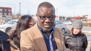 Frederic Kouakou, father of missing boy Ariel Jeffrey Kouakou, speaks to the media Thursday, March 22, 2018 in Montreal. The boy left his home in the city's north end on March 12 to visit a friend's house.THE CANADIAN PRESS/Ryan Remiorz