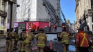 Firefighters have extinguished the main body of fire at 93 Sparks Street. Crews are continuing to overhaul and check for extension. Correction in building height: it has 4 floors. (ScottStillborn/@OFSFirePhoto/Twitter)