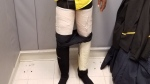 This photo provided by the U.S. Customs and Border Protection shows a Fly Jamaica Airways crew member as he was searched and arrested at New York's Kennedy Airport with four packages of cocaine taped to his legs on Saturday, March 17, 2018. (U.S. Customs)
