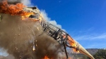 In a Thursday, March 22, 2018 photo provided by the Royal Gorge Dinosaur Experience, a life-sized animatronic Tyrannosaurus Rex at the Royal Gorge Dinosaur Experience in Canon City, Colo., is ablaze after an electrical issue, according to Royal Gorge Dinosaur Experience personnel. (Royal Gorge Dinosaur Experience)