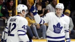 Toronto Maple Leafs left wing James van Riemsdyk (25) and Tyler Bozak (42) celebrate after van Riemsdyk scored a goal against the Nashville Predators in the first period of an NHL hockey game Thursday, March 22, 2018, in Nashville, Tenn. (AP Photo/Mark Humphrey)