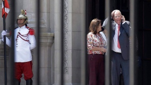 In this Wednesday, March 21, 2018 photo, Peru's President Pedro Pablo Kuczynski talks on his cellphone as he vacates the House of Pizarro, the presidential residence and workplace, in Lima, Peru.  (AP Photo/Martin Mejia)