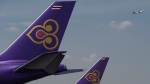 Thai Airways is getting flak after banning oversized passengers from flying business class aboard its newly acquired Dreamliner aircrafts, for safety reasons. (© CHRISTOPHE ARCHAMBAULT / AFP)