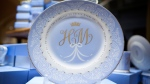 A plate with the initials H and M which forms part of the new official range of china to celebrate the future marriage of Prince Harry and Meghan Markle is displayed in The Queen's Gallery shop at Buckingham Palace, London, Wednesday March 21, 2018. (Rick Findler/PA via AP)