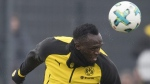 Jamaica's former sprinter Usain Bolt, heads the ball during a practice session of the Borussia Dortmund soccer squad in Dortmund, Germany, on March 23, 2018. (Bernd Thissen/dpa via AP)
