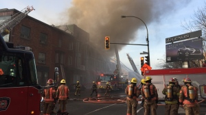 A fire in an abandoned building near the Bell Centre broke out at 5:30 a.m. on Friday, March 23, 2018. (Photo: Christophe Terrade/CTV Montreal)