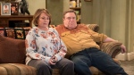 "In this image released by ABC, Roseanne Barr, left, and John Goodman appear in a scene from the reboot of ""Roseanne."" (Adam Rose/ABC via AP)"