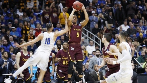 Loyola-Chicago guard Marques Townes (5) makes a three-point shot in Atlanta on March 22, 2018. (David Goldman / AP)