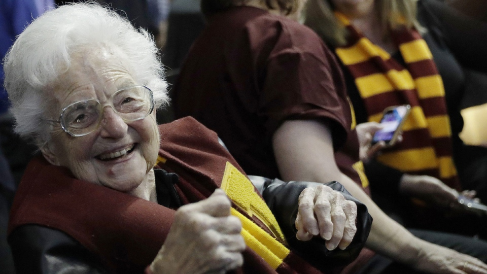 Sister Jean Dolores Schmidt sits with other Loyola-Chicago fans in Atlanta on March 22, 2018. (David Goldman / AP)