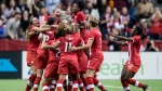 Canadians celebrate a goal against the United States, in Vancouver on Nov. 9, 2017. (Darryl Dyck / THE CANADIAN PRESS)