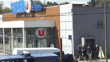 Police outside a supermarket in Trebes, France