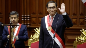 Peru's newly-sworn in President Martin Vizcarra waves, flanked by National Congress President Luis Galarreta, in Lima, Peru, Friday, March 23, 2018. (Martin MejiaAP Photo)