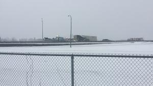 A semi sits jackknifed on Saskatoon's Circle Drive, near 22nd Street, as blowing snow sweeps across the city Friday, March 23, 2018. (Jim Barnsley/CTV Saskatoon)