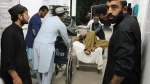 A wounded man is assisted in a hospital, after a car bombing outside a sports stadium in Lashkargah, capital city of southern Helmand province, Afghanistan, Friday, March 23, 2018. (AP / Abdul Khaliq)