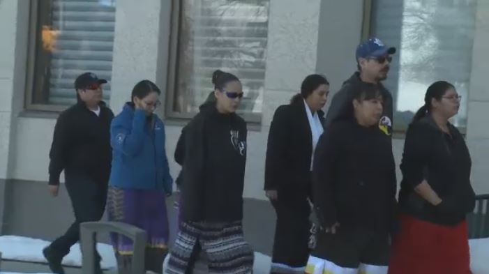 Tia Pinacie-Littlechief is part of a group of people walking into Court of Queen's Bench on March 23, 2018