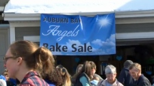 Hundreds of people took part in a community bake sale on Friday supporting the family of Noah Catto