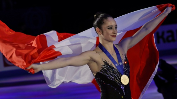 Kaetlyn Osmond of Canada celebrates after winning the women's free skating program, at the Figure Skating World Championships in Assago, near Milan, Italy, Friday, March 23, 2018. (AP Photo/Luca Bruno)