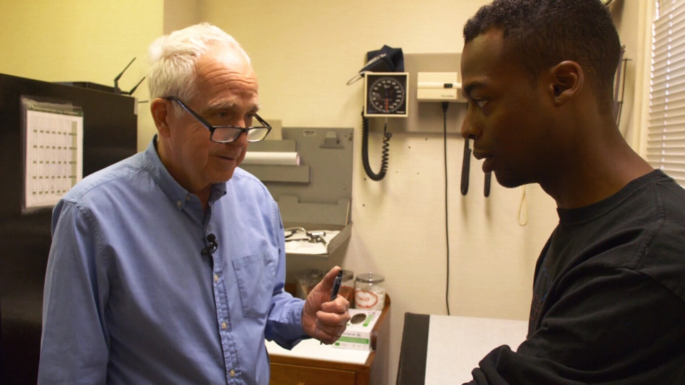 Dr. Gordon Sussman, left, tests Doneil Oliphant for an allergic reaction.