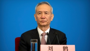 Vice Premier Liu He attends a press conference after the closing session of China's National People's Congress (NPC) at the Great Hall of the People in Beijing, Tuesday, March 20, 2018. (AP Photo/Mark Schiefelbein)
