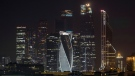 Moscow city with skyscrapers illuminated before the lights were turned off, for one hour to mark Earth Hour in Moscow, Russia, Saturday, March 25, 2017. Earth Hour is marked around the world, with millions expected turn out the lights to raise awareness about climate change. (AP Photo/Denis Tyrin)