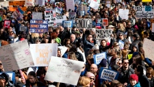 People take part in a march rally against gun violence Saturday, March 24, 2018, in New York. Tens of thousands of people poured into the nation's capital and cities across America on Saturday to march for gun control and ignite political activism among the young. (AP Photo/Craig Ruttle)
