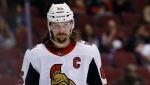 In this March, 3, 2018, file photo, Ottawa Senators defenseman Erik Karlsson pauses on the ice during the second period of the team's NHL hockey game against the Arizona Coyotes in Glendale, Ariz. (AP Photo/Ross D. Franklin, File)