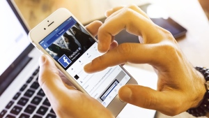 A Facebook user scrolls through the app in this undated file photo. (bombuscreative/IStock.com)