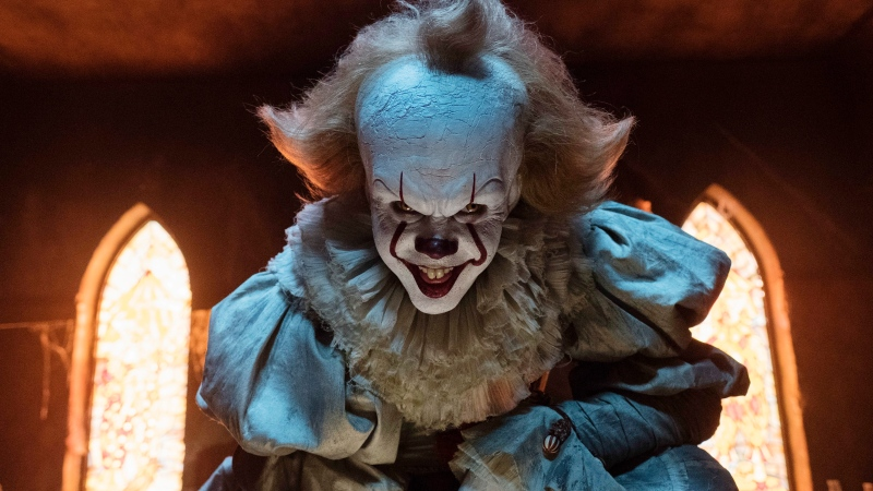 "This image released by Warner Bros. Pictures shows Bill Skarsgard as the evil clown Pennywise in a scene from the film ""It,"" based on the book by Stephen King. (Brooke Palmer/Warner Bros. Pictures via AP)"