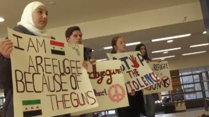 Students, parents and teachers stood in solidarity at a rally for peace and non-violence Saturday afternoon at Wilfrid Laurier University.