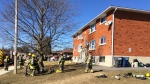 Fire officials responded to the unit on Woolley Street in Cambridge around 2:30 p.m.