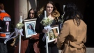 Funeral-goers exit the funeral for triple homicide victims Krassimira, Roy, and Venallia Pejcinovski of Ajax at the St. Demetrios Greek Orthodox Church in Toronto on Saturday, March 24, 2018. THE CANADIAN PRESS/Chris Donovan