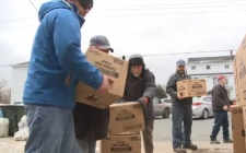 Volunteers help unload 15,000 boxes of cereal brought by Fraser MacAulay.