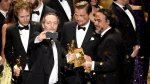 Emmanuel Lubezki, from left, Leonardo DiCaprio, and Alejandro G. Inarritu take a selfie on stage at the conclusion of the show at the Oscars on Sunday, Feb. 28, 2016, at the Dolby Theatre in Los Angeles. (Photo by Chris Pizzello / Invision / AP)