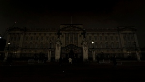 Buckingham Palace in London after it switched off its lights for an hour to mark WWF's Earth Hour to raise awareness about climate change, Saturday March 24, 2018. (Jonathan Brady/PA via AP)