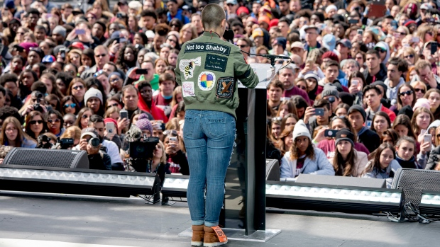 "Emma Gonzalez, a survivor of the mass shooting at Marjory Stoneman Douglas High School in Parkland, Fla., speaks during the ""March for Our Lives"" rally in support of gun control in Washington, Saturday, March 24, 2018. (AP Photo / Andrew Harnik)"