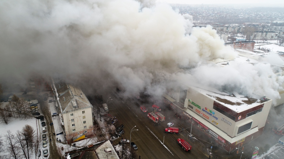 In this Russian Emergency Situations Ministry photo, on Sunday, March 25, 2018, smoke rises above a multi-story shopping center in the Siberian city of Kemerovo, about 3,000 kilometers east of Moscow, Russia. (Russian Ministry for Emergency Situations)