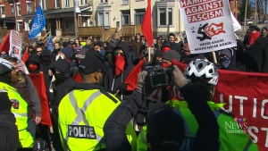 """Police clash with """"anti-fascist"""" protesters in Hamilton, Ont., on Sunday, March 25, 2018."""