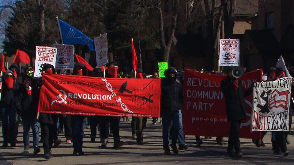 """Anti-fascist"" protesters march in Hamilton, Ont., on Sunday, March 25, 2018."
