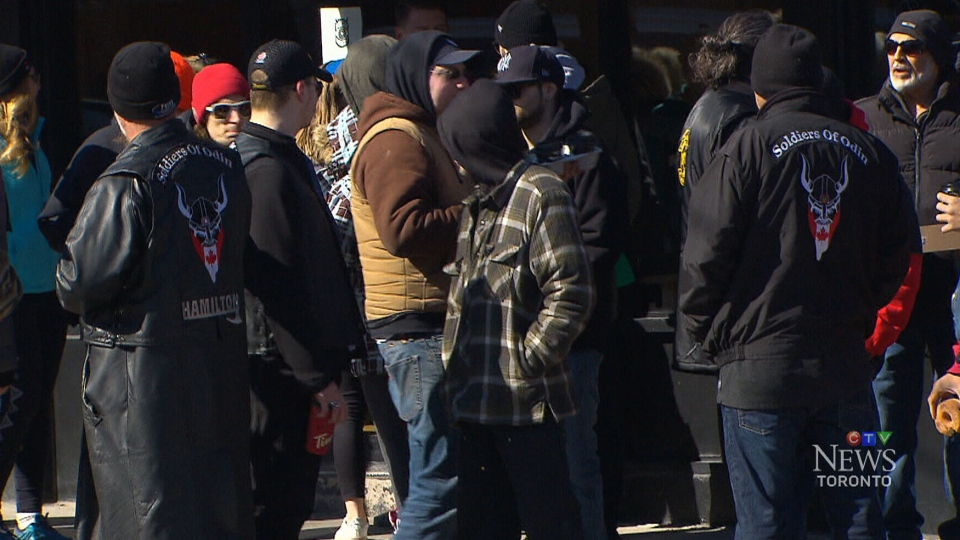 "Men in Soldiers of Odin jackets gather at the ""Walk on Locke"" in Hamilton, Ont., on March 25, 2018."