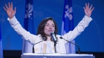 Newly acclaimed Bloc Quebecois leader Martine Ouellet salutes supporters during a rally Saturday, March 18, 2017 in Montreal. THE CANADIAN PRESS/Paul Chiasson